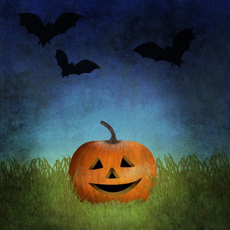 Jack o lantern among grass with bats flying in the sky above him