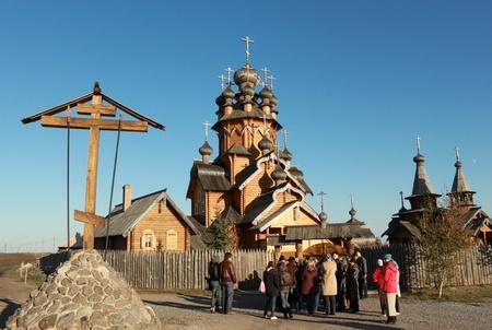 introduces: Svyatogorsk, Ukraine - October 16, 2010. Skeet All Saints Svyatogorsk Holy Assumption Monastery. Monk introduces visitors to the temple