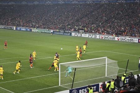 DONETSK, UKRAINE - NOVEMBER 3, 2010: Epizode Champions League match in Donetsk Donbass Arena November 3, 2010. Dmytro Chygrynskiy (No. 27 FC Shakhtar Donetsk) scoring a goal against Arsenal London