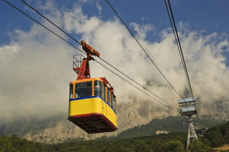 The cable car in Crimea Ai-Petri on a background of mountains covered with clouds photo