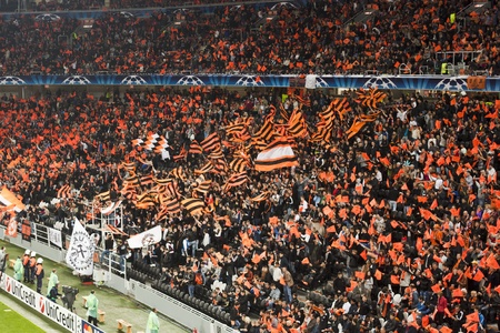 DONETSK, UKRAINE - SEPTEMBER 28, 2011: The match of the Champions League FC Shakhtar Donetsk vs. FC Apoel Cyprus in Donetsk Donbass Arena on September 28, 2011. Fans do not help - the match ended in a draw