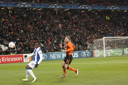 DONETSK, UKRAINE - NOVEMBER 23, 2011:  Forward Djalma (No. 20, Porto) and defender Olexandr Kucher (No. 5, Shakhtar) in the match of the Champions League FC Shakhtar Donetsk vs. FC Porto in Donetsk Donbass Arena on November 23, 2011.