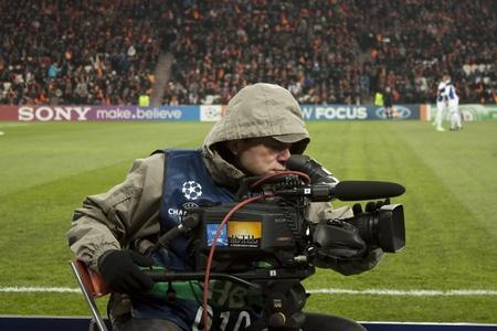 donbass: DONETSK, UKRAINE - NOVEMBER 23, 2011: Unidentified cameraman working on the match of the Champions League FC Shakhtar Donetsk vs. FC Porto in Donetsk Donbass Arena on November 23, 2011