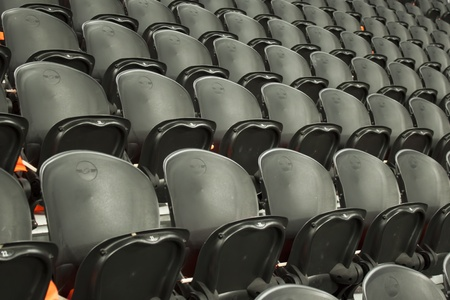 A rows black seats on the stadium Stock Photo - 12906958