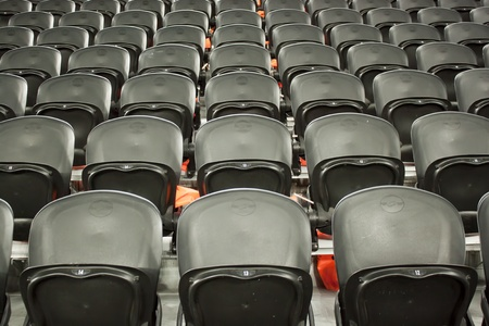 reserved seat: A rows black seats on the stadium