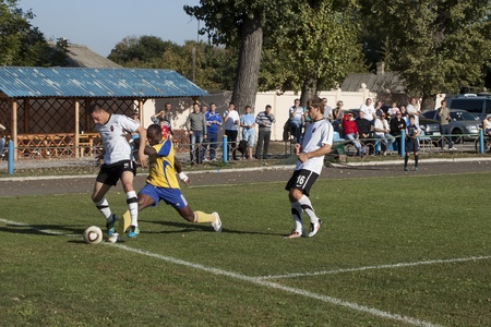 luhansk: SLOVIANSK, UKRAINE - 21 SEPTEMBER 2011: Fragment of the match of 116 Datagroup Cup of Ukraine between Slovkhlib Sloviansk (in yellow) vs Zoria Luhansk (in white) on 21 September 2011 in Sloviansk. Zoria Luhansk won 2-0