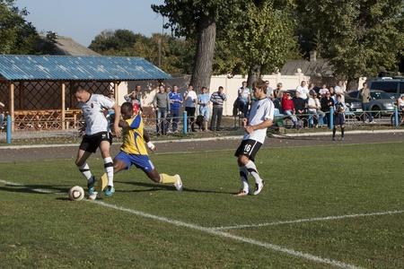 luhansk: SLOVIANSK, UKRAINE - 21 SEPTEMBER 2011: Fragment of the match of 116 Datagroup Cup of Ukraine between Slovkhlib Sloviansk (in yellow) vs Zoria Luhansk (in white) on 21 September 2011 in Sloviansk. Zoria Luhansk won 2-0