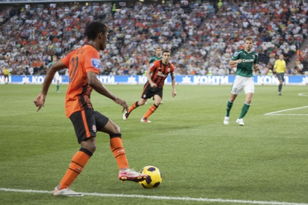 DONETSK, UKRAINE - JULY 10, 2011. Brazilian Douglas Costa (No 20) with the ball in the first match of Championship of Ukraine 2011-2012 in Donbass Arena between Shakhtar Donetsk and Kiev Obolon.