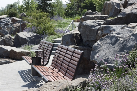 Empty benches in the garden of stones in the park at Donbass Arena photo