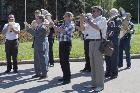SLAVYANSK, UKRAINE - MAY 1, 2012: Amateur brass band plays on the square in Slavyansk during the meeting on May 1