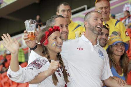 DONETSK, UKRAINE - JUNE 19, 2012: England fan between the Ukrainian fans before the match of EURO 2012 Ukraine vs. England in Donetsk at Donbass Arena Stadium on June 19, 2012. Stock Photo - 14146567