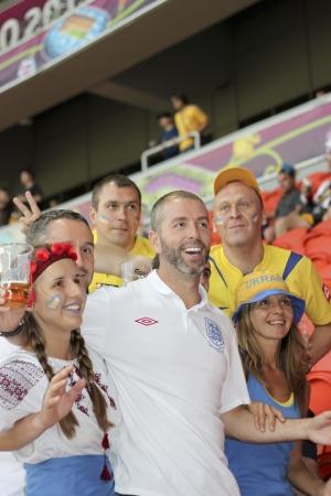 DONETSK, UKRAINE - JUNE 19, 2012: England fan between the Ukrainian fans before the match of EURO 2012 Ukraine vs. England in Donetsk at Donbass Arena Stadium on June 19, 2012.