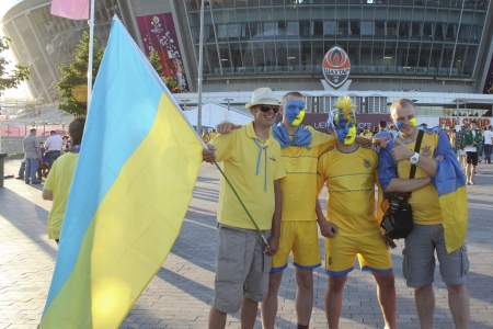 donbass: DONETSK, UKRAINE - JUNE 19, 2012: Ukrainian fans before the match EURO 2012 Ukraine vs. England in Donetsk at Donbass Arena. They do not know that they will lose their favorite team 0 - 1.