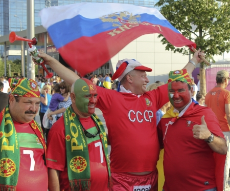 DONETSK, UKRAINE - JUNE 27, 2012: Fan of Russia together with the fans of Portugal in Donetsk before the semi-final match of UEFA EURO 2012 Spain vs. Portugal. The Portuguese do not yet know that their team does not qualify for the finals...