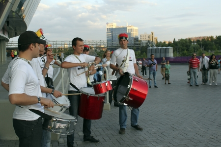 DONETSK, UKRAINE - JUNE 27, 2012: Ensemble of drummers before the semi-final match of UEFA EURO 2012 Spain vs. Portugal in Donetsk near Donbass Arena. Drummers are usually accompanied by performance of football freestylers