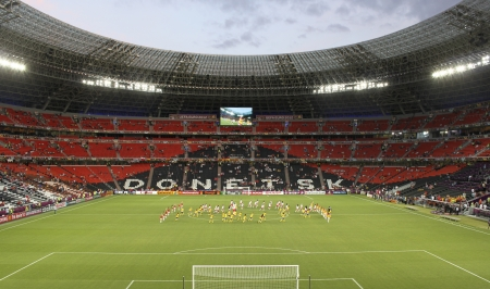 donbass: DONETSK, UKRAINE - JUNE 27, 2012: Performance of Team Support Groups before the semi-final match of UEFA EURO 2012 Spain vs. Portugal in Donetsk Donbass Arena