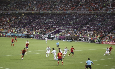 euro area: DONETSK, UKRAINE - JUNE 27, 2012: Fragment of the semi-final match of UEFA EURO 2012 Spain vs. Portugal in Donetsk. Jesús Navas (No. 22, Spain) with the ball in the opponents penalty area Editorial
