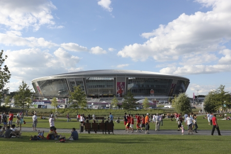donbass: DONETSK, UKRAINE - JUNE 27, 2012: Stadium Donbass Arena before the semi-final match of UEFA EURO 2012 Spain vs. Portugal in Donetsk. At this stadium played five matches of UEFA EURO 2012 crowded the tribunes