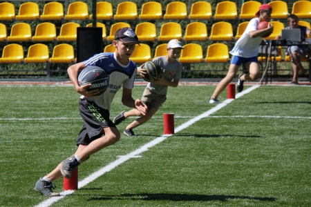 SVIATOHIRSK, UKRAINE ? JULY 30, 2012: Unidentified boy runs with ball during the relay race in the children