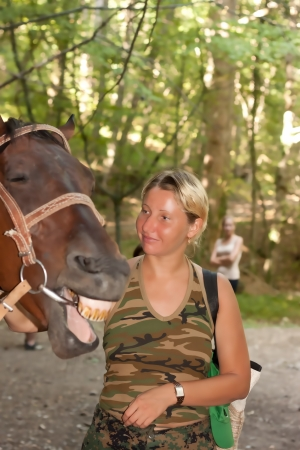 Girl and horse in the Crimean forest photo