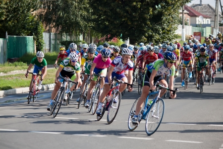 SVYATOGORSK, UKRAINE - SEPTEMBER 5, 2012: On the 3rd stage of the International Youth Friendship cycling, dedicated to the 69th anniversary of the liberation of Donbass from invaders. Distance of 75 km. This competition involved 112 riders from seven coun Stock Photo - 15102697