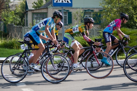 SVYATOGORSK, UKRAINE - SEPTEMBER 5, 2012: On the 3rd stage of the International Youth Friendship cycling, dedicated to the 69th anniversary of the liberation of Donbass from invaders. Distance of 75 km. This competition involved 112 riders from seven coun Stock Photo - 15102695