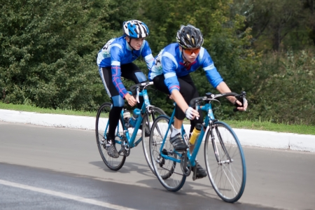 SVYATOGORSK, UKRAINE - SEPTEMBER 5, 2012: On the 3rd stage of the International Youth Friendship cycling, dedicated to the 69th anniversary of the liberation of Donbass from invaders. Distance of 75 km. This competition involved 112 riders from seven coun