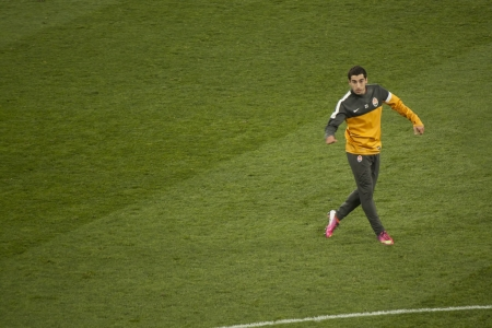 DONETSK, UKRAINE - FEBRUARY 13, 2013: Shakhtar player Armenian Henrik Mkhitaryan warming up before the match of the Champions League with Borussia Dortmund in Donetsk