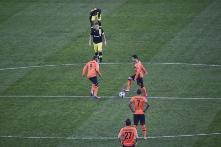 DONETSK, UKRAINE - FEBRUARY 13, 2013: Shakhtar players begin to Champions League match between Borussia Dortmund and Shakhtar Donetsk. The final score was 2 - 2