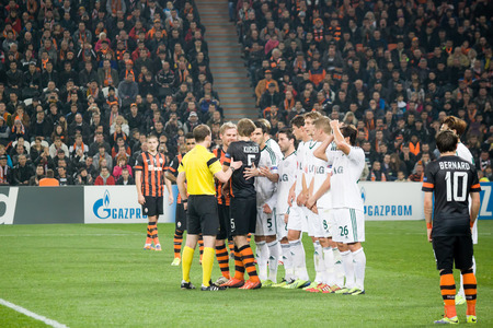 donbass: DONETSK, UKRAINE - NOVEMBER 5, 2013  Referee William Collum  SCO  versed with the  wall  of players Leverkusen in the Champions League match in Donetsk Donbass Arena November 5, 2013  The match between FC Shakhtar Donetsk and Leverkusen ended in a goalles Editorial