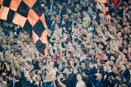 donbass: DONETSK, UKRAINE - NOVEMBER 5, 2013  Fans, despite the efforts have not helped in the Champions League match in Donetsk Donbass Arena November 5, 2013  The match between FC Shakhtar Donetsk and Leverkusen ended in a goalless draw
