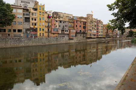 GIRONA, SPAIN - JULY 17, 2013  Quay Girona on July 17, 2013  Well preserved since the Middle Ages the historic core of the city attracts a significant number of tourists
