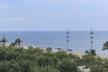 beach window: The beach of Calella, Spain. View from hotel window