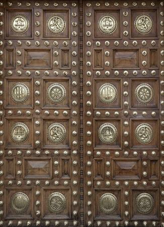 large doors: Large wooden doors decorated with metal rivets and minting