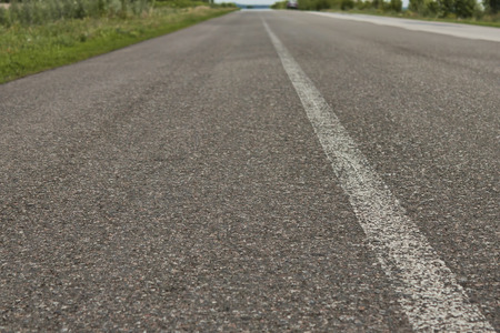 abrupt: The asphalt road with white continuous strip. No car Stock Photo