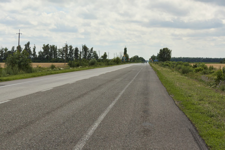 continuation: The asphalt road with white continuous strip. No car Stock Photo