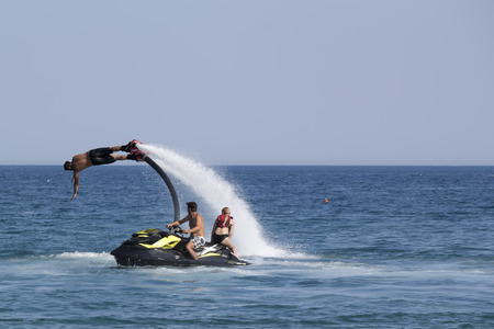 jet skier: CAMYUVA, KEMER, TURKEY - JULY 16, 2015: Unidentified Turkish man demonstrates flyboard acrobatics on the beach of Camyuva. Extreme water sports are increasingly popular on the beaches of Turkey