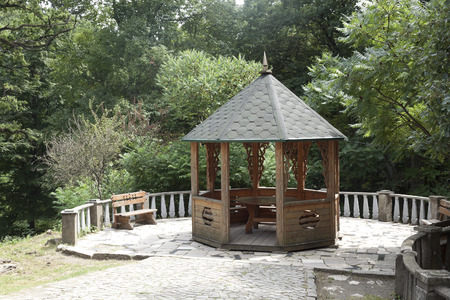 summerhouse: A wooden gazebo in the park Schonborn. Ukraine, Transcarpathia, Karpaty sanatorium Stock Photo