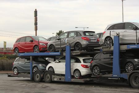 conveyance: PRAGUE, CZECH REPUBLIC - NOVEMBER 2, 2012: New Cars Mercedes on a conveyance platform ready for delivery