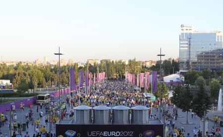 donetsk: DONETSK, UKRAINE - JUNE 19, 2012: Fans go to the EURO 2012 match in Donetsk at Donbass Arena