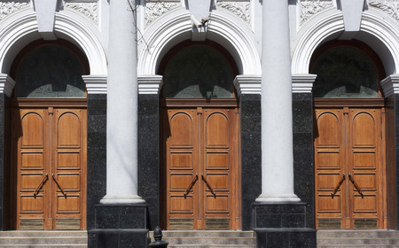 large doors: Three large doors in building with columns