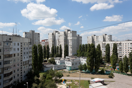 apartment blocks: The courtyard between the Kharkiv Soviet-built apartment blocks party-cloudy summer day. Ukraine, June 2016