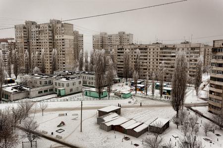 apartment blocks: The courtyard between the Kharkiv Soviet-built apartment blocks cloudy winter day. Ukraine, February 2015 Stock Photo