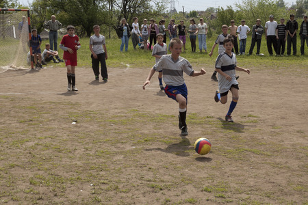 boys playing: SLOVIANSK, UKRAINE - MAY 17, 2011: Unidentified boys playing soccer on the school sports ground. Soccer - one of the favorite games of boys Ukraine Editorial
