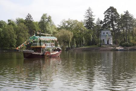 pleasure craft: UMAN, UKRAINE - MAY 2, 2013: Pleasure craft Sofia in the lake in Sophia park in Uman