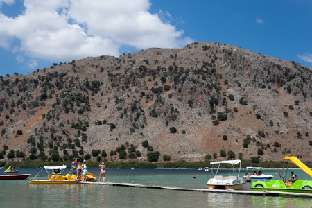 kournas: KOURNAS, CRETE, GREECE - AUGUST 2, 2013: Kournas - the largest freshwater lake in Crete, attracts many tourists who are ready to take a ride on boats and water bikes