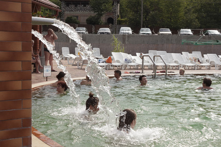 hydromassage: BEREGOVO, UKRAINE - JULY 4, 2015: The hydromassage in the pool with thermal waters in Beregovo. There is always a lot of people at any time of the year Editorial