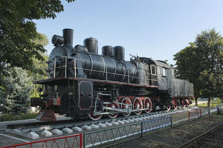 xx century: SLOVIANSK, UKRAINE - AUGUST 1, 2010: Steam locomotive - a museum piece near Sloviansk  locomotive depot. With this locomotive driver Petro Krivonos set traffic records in the 30-ies of XX century