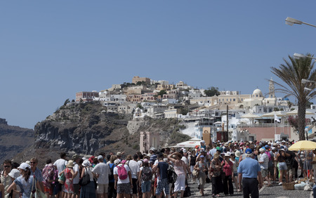 thira: THIRA, SANTORINI, GREECE - AUGUST 8, 2013: A lot of tourists on the streets of Thira. Santorini is always a lot of tourists