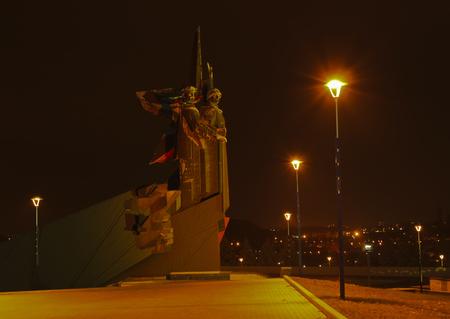 yui: DONETSK, UKRAINE - NOVEMBER 5, 2010: Monument Liberators of Donbass (Sculptor Yu.I. Baldin, A.N. Porozhnyuk, Architect V.P. Kishkan, M. J. Ksenevich) evening near the stadium Donbass Arena.